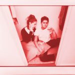 butch femme lesbian couple in the closet
