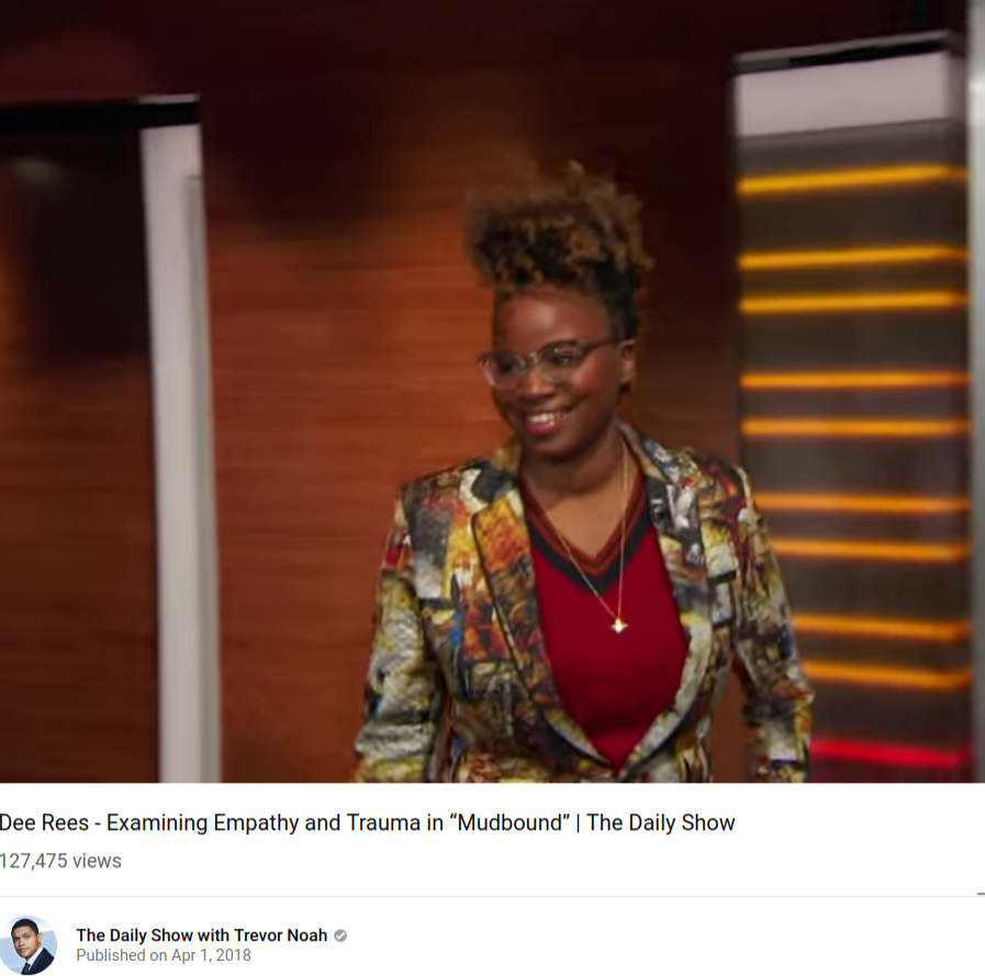 screenshot: Lesbian History, Dee Rees, a lesbian, is the first black woman to be nominated for an Oscar for an adapted screenplay. (on youtube, The Daily Show)