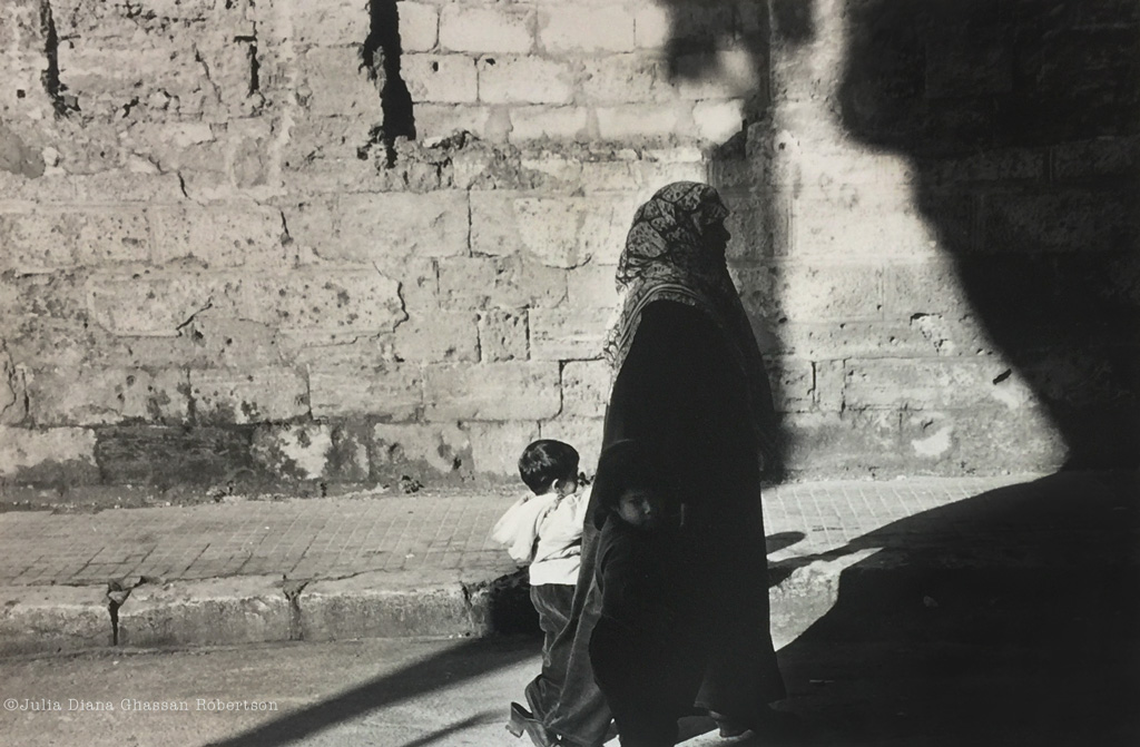 woman in hijab with girl in the shadows, boy in the light, Liban
